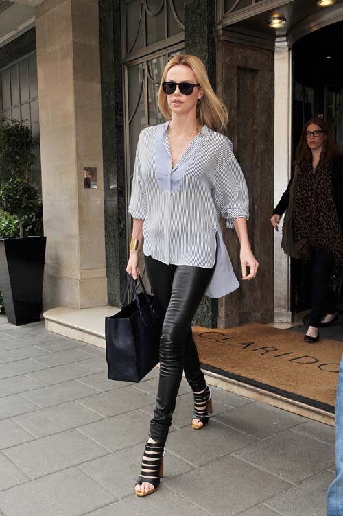 charlize theron wears stella mccartney, the row, and christian louboutin
