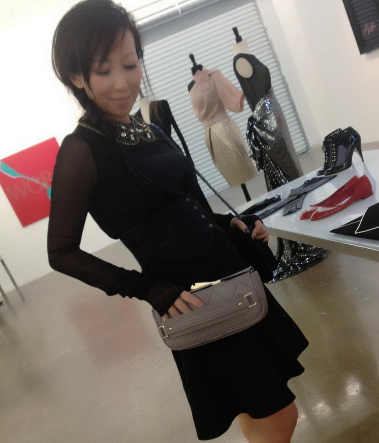 Bag Snob TIna holds a bag for sale on ModeWalk