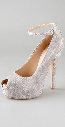 giuseppe_zanotti_snake_platform_pumps_with_ankle_strap.jpg