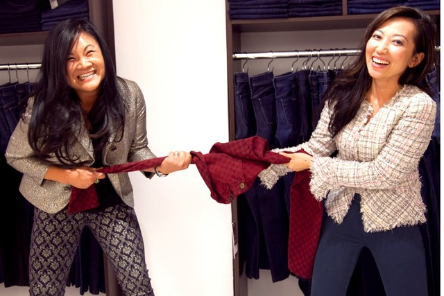 Tina Craig and Kelly Cook holding a pair of jeans from the Dl1961 x Bag Snob Collaboration